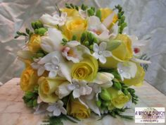 A textures bouquet with roses, freesia, orchids and other seasonal flowers.