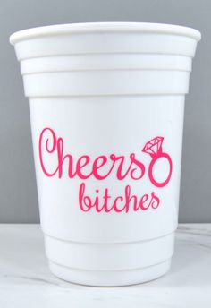 "Bachelorette party cups - ""Cheers bitches"" Available in tons of colors and you can add names to the opposite side."