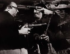 Sergio Leone & Jason Robards playing with the guns on the set of Once Upon a Time in the West, 1968.