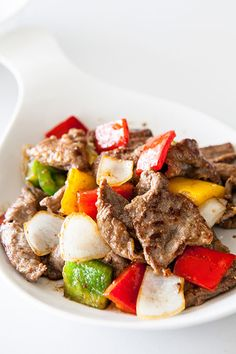 """With her new KitchenAid® 36"""" Retractable Downdraft System, Jaden of @steamykitchen can stir fry Black Pepper Steak without worrying about excessive heat and smoke. Get her recipe on our blog."""