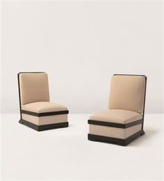 JACQUES ADNET Pair of low chairs, ca. 1930  Leather-upholstered metal, fabric, brass (2). Each: 34 1/2 x 31 1/2 x 21 7/8 in (87.6 x 80 x 55.6 cm)