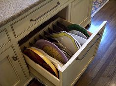 Don't forget base cabinets. If your platters are heavy or you use them often, keep them at hand in deep, partitioned drawers. No stools needed to find what you're looking for. Space Saving Storage, Storage Spaces, Kitchen Redo, Kitchen Remodel, Kitchen Ideas, Kitchen Designs, Kitchen Organization, Kitchen Storage, Kitchen Organizers