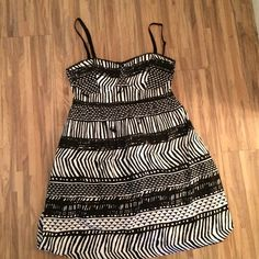Roxy dress. Black and white print. New without tags. Never worn excellent condition! Roxy Dresses