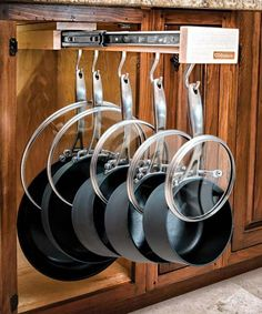 Pans and raised- handle lids are easy to grab yet out of sight with this slide-out. The rack, which can handle 100 pounds, comes with heavy-duty hooks and an easy-install mounting bracket; you provide the empty cabinet.  About $200 from Glideware. | thisoldhouse.com