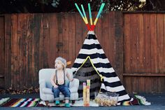 I love this idea though I feel the bold color of the props drown out the boy. James and his teepee | full photo shoot on Hopes & Dreams