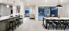 open plan living | APG Homes Our concrete wallpaper used