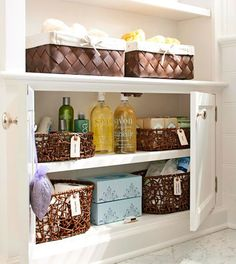 Organize bathroom cabinets with baskets (Love these Seagrass Baskets and Woven ones with liners) #Bathroom #Organization #BathroomDecor
