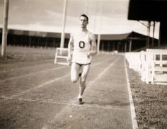 Black and white photo of an unidentified University of Oregon track athlete running at Hayward Field some time during the 1940s. ©University of Oregon Libraries - Special Collections and University Archives