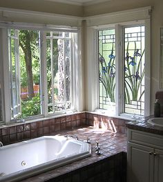 Stained glass windows by the bathtub