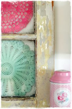 old crochet doily in an old door