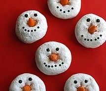 Snowman donuts, candy corn for nose and icing for eyes and smile!