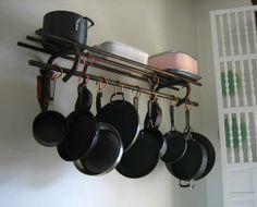 Luggage rack as pot rack - wow, if I didn't have a pot rack, I would seek out one of these!