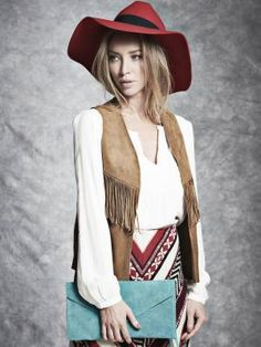 Today marks the launch of TV personality Lauren Pope's debut accessories collection in collaboration with Accessoryo. Taking inspiration from 70's boho looks, the capsule line of handpicked pieces includes embellished fedoras, feather necklaces, rainbow clutches and metallic details. The collection is available online with prices ranging from £10-60.