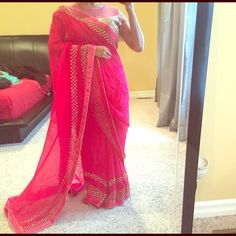 Shop Women's Pink Gold size S/M Dresses at a discounted price at Poshmark. Description: Gorgeous hot pink Bollywood style Indian saree. The blouse is the showstopper here - mirror work all over front and back with sheer net neckline. 😍 saree has mirror work border all over. Comes with underskirt/petticoat.. Sold by noopur1987. Fast delivery, full service customer support.