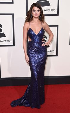 Selena Gomez is stunning in a dazzling midnight blue Calvin Klein gown at the Grammys 2016.