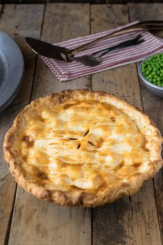 Steak and ale pie is a British classic found at most pubs around England. Serve it with pea and chips for a perfectly comforting meal.