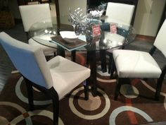 Glass table top with upholstered chairs. #hpmkt
