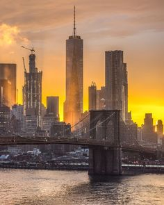 The Brooklyn Bridge and Lower Manhattan at sunset. then share your city! Manhattan Times Square, Lower Manhattan, Manhattan Nyc, Brooklyn New York, Brooklyn Bridge, Little Italy New York, New York Tattoo, Watercolor City, City Tattoo