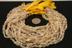 1strand  natural golden rutilated quartz plain oval sized by 3yes