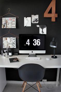 black wall, white desk