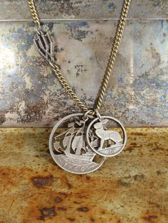 Ship and Rabbit Coin Necklace. always loved that cut coin jewelry.