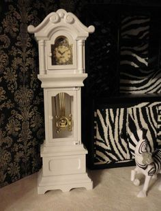 "BARBIE WHITE OOAK GRANDFATHER CLOCK HOUSE FURNITURE / FREE SHIPPING (most of the 1:6 scale grandfather clocks I've seen on eBay are too short - I can make this with a long bracelet jewelry box or small spaghetti box, a smaller box & a couple of box lids & extra cardboard, scrapbook &/or other embellishments, pictures of pendulum window and clock window or I can make this 3D w/watch face and ""gold"" button, etc..I like to use jewelry boxes because they're sturdy - kj)"