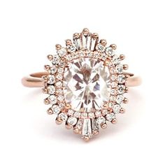 Not your average halo! This unique art deco-style engagement ring is beyond stunning, and the rose gold makes it an automatic yes.