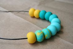 Sunshine and surf in a necklace!  Polymer clay bead necklace/ lemon yellow, aqua, teal beads / handmade by AquaIsleDesign on Etsy