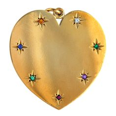 """1940's Tiffany 14K gold charm. The stones in the heart, diamond, emerald, amethyst,ruby,emerald, sapphire and topaz spell """"DEAREST"""""""