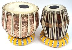Tabla. The tabla is a percussion instrument used in Hindustani classical music and in popular and devotional music of the Indian subcontinent. The instrument consists of a pair of hand drums of contrasting sizes and timbres. The tabla is used in some other Asian musical traditions outside of India. Playing technique involves extensive use of the fingers and palms in various configurations to create a wide variety of different sounds, reflected in the mnemonic syllables (bol).