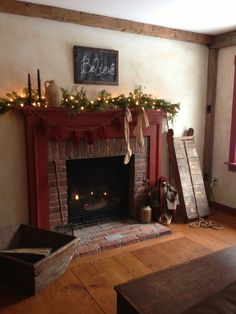 Gas fireplace with colonial mantle style decorated for a Primitive Christmas