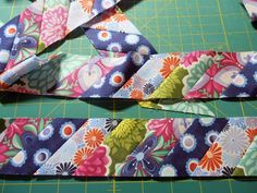 A Quilter's Table: Striped Binding. Great idea for binding up a scrappy quilt or bringing all the colors of the quilt blocks together!