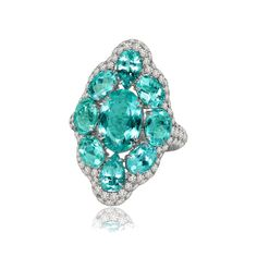 This Paraiba tourmaline ring in white gold by Sutra is set with diamonds and Paraibas from Mozambique. Discover the popular fashionable gemstone that high jewellery brands are using that has the electric blue hue we're all coveting: http://www.thejewelleryeditor.com/jewellery/paraiba-tourmalines-brazilian-african-what-is-the-difference/ #jewelry