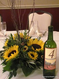 Sunflower Wedding Centerpieces | Sunflower centerpieces were finished off with wine bottle table ...