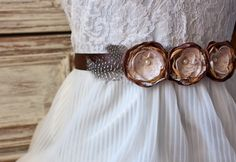 rosebud fabric flower belt in brown, gold, and caramel brown with feathers