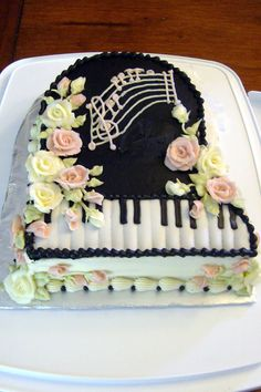"Buttercream rose piano cake.  ""Hey Mom, do you think you could make this for my birthday?"""