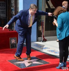 Actor John Goodman cavorts over his star during an unveiling ceremony honoring him with the 2,064th star on the Hollywood Walk of Fame in…
