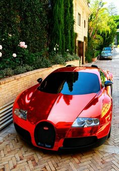 Bugatti Veyron - An extremely amazing looking car...... especially in red!!