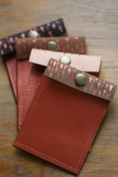 Copper Arrow Recycled Leather Wallets: hand-painted on recycled leather. [via madebyrachel]