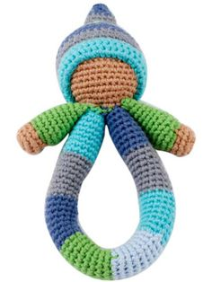 Pixie Rattle from Shopping for a Change - $14.00 USD -   100% Cotton Yarns, 100% Polyester fill. Hand knitted and crocheted. Cuddly and fun. No sharp edges. Machine washable in warm water, tumble dry low setting. Meets all U.S. Consumer Product Safety Regulations.