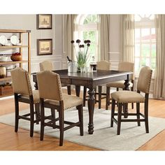 This Garrett 7 Piece Counter Height Dining Set includes (1) counter height table that is crafted of 100% solid hard wood with an 18 inch self stored butterfly leaf. Description from dealepic.com. I searched for this on bing.com/images