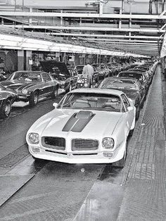 In the presence of greatness. A view of the Pontiac assembly line with a waiting Trans Am Pontiac Cars, Chevrolet Camaro, 1970 Camaro, Chevrolet Dealership, General Motors, Buick, Porsche 911, Hot Rods, Volkswagen