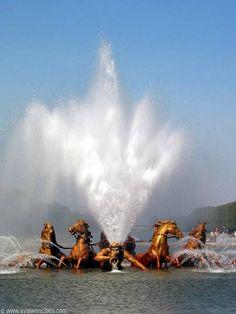 The magnificent Apollo fountain in the gardens of Chateau de Versailes