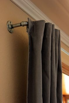 Drop cloths!!!! Why havent i thought of this yet?!? Dyed drop cloths with DIY curtain rod