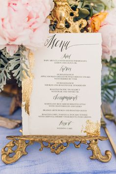 gold foil menu - photo by Michelle Roller Photography http://ruffledblog.com/windswept-bridal-editorial-on-the-beach