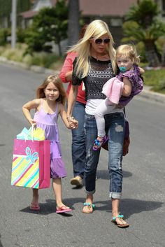 Beverly Hills, 90210 alum Tori Spelling was spotted with her two daughters – Stella, nearly 6, and Hattie, 2 – on Saturday (April 12). The trio attended a Frozen-themed birthday party in Hollywood, Calif.  The McDermott sisters looked pretty in matching purple outfits, while mama went chic in jeans and layered black and white tops.