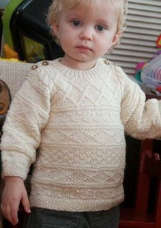 Free Knitting Pattern for Baby Gansey Sweater - This Easy Baby Aran pullover features gansey texture stitch patterns and buttons at the shoulders for easy dressing. Designed by Sarah Hoffman. Size 12 to 28 months / 20 inch chest finished size.