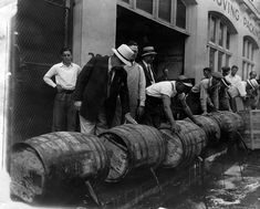 Prohibition agents dumping liquor. 1931.