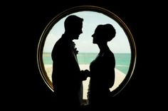 Bride and groom porthole silhouette on the Disney Dream