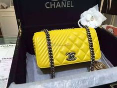 For those that love to be different in style, why not consider the Chanel Small Coco Boy Flap Bag. The Chanel Small Coco Flap Bag is a beautiful thing, it fits perfect in your wardrobe, doesn't it? A simple yet impressive accessory, it features the iconic Boy Clasp. This bag is made from lambskin. Price $450.00